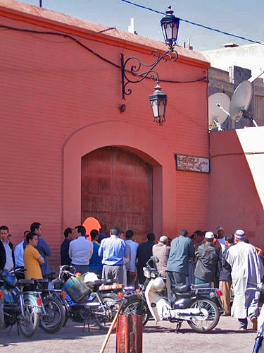 Men gather outside mosque