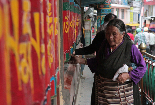 Tibetan women at the prayer wheels, tibetan religion, prayer wheels tibet