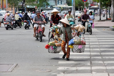 crossing a street in Ho Chi Minh Vietnam