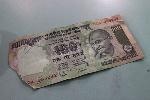 dealing with Indian currency and a torn rupee