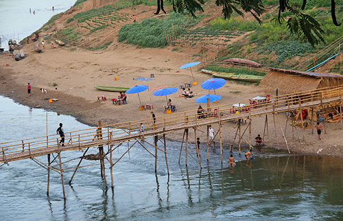 Beach in Luang Prabang, beaches in laos, man-made bridge in laos