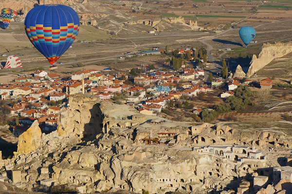 taking a hot air balloon ride over Uchisar Castle